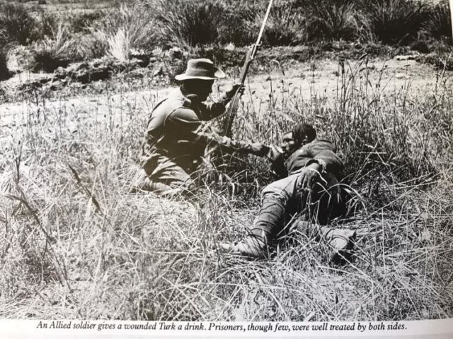 English soldier gives water to wounded Turk